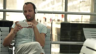 dude watching phone